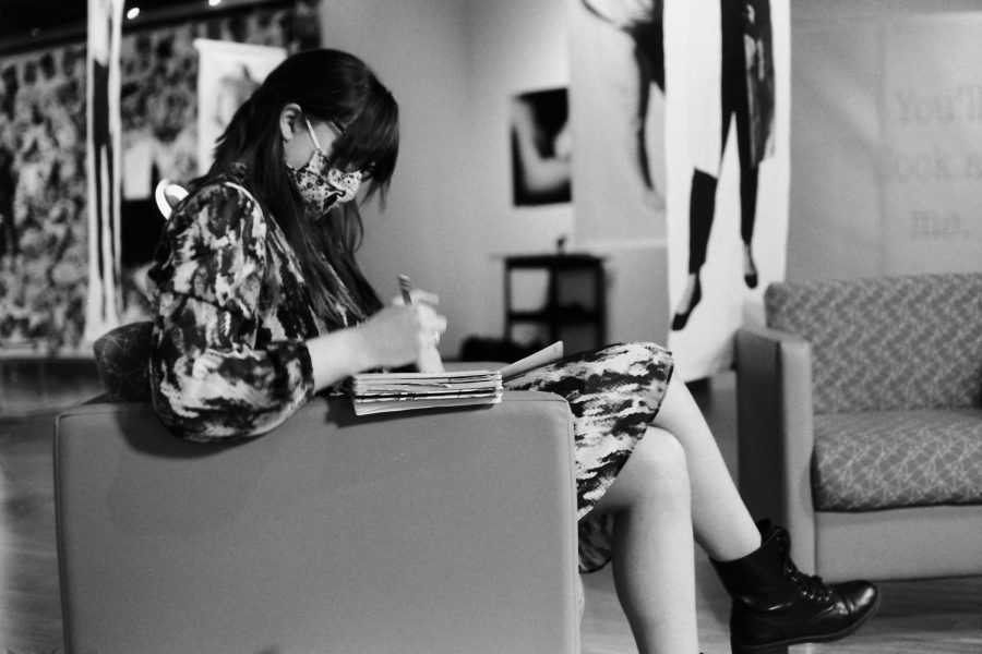 Megan Thorne takes notes in The McCutchan Art Center before a webinar, February 3, 2021.