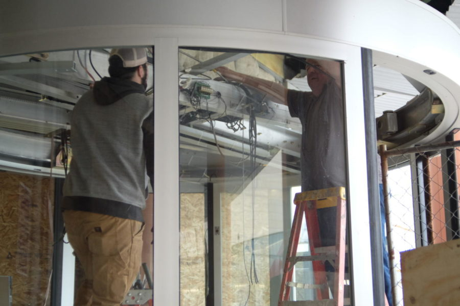 Photo of Workers removing the door in January