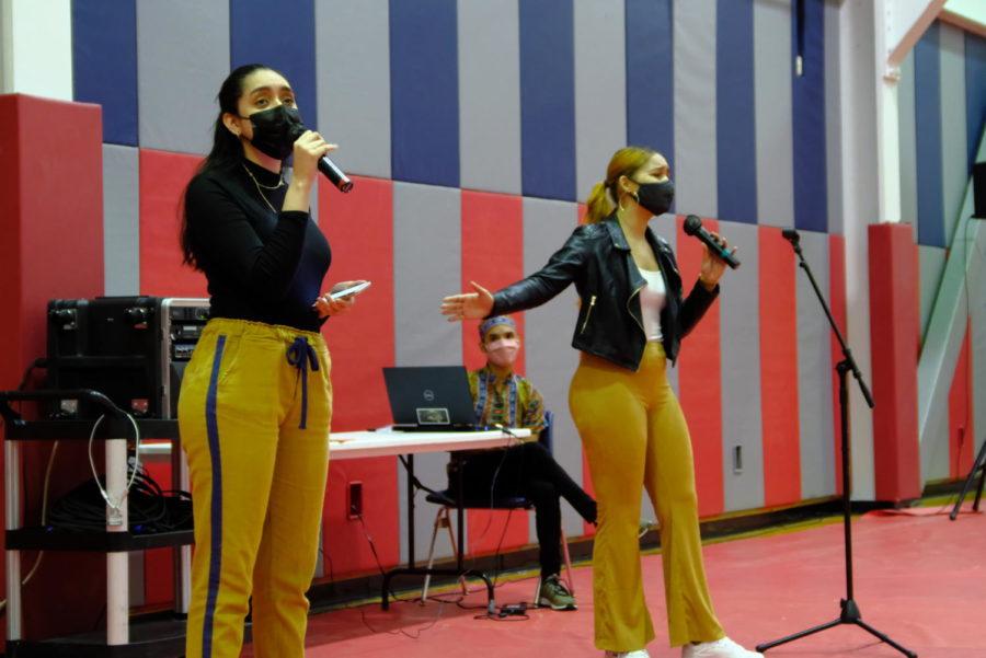 Anna Gonzalez, junior psychology major, and Siara Jimenez, university alumni sing