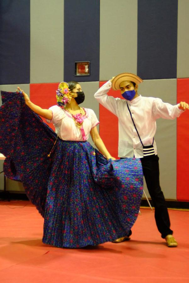 Claberith Delena, English program student, and Eric Espino, freshman civil engineering major, dance the cumbia, a traditional folk dance from Latin America.