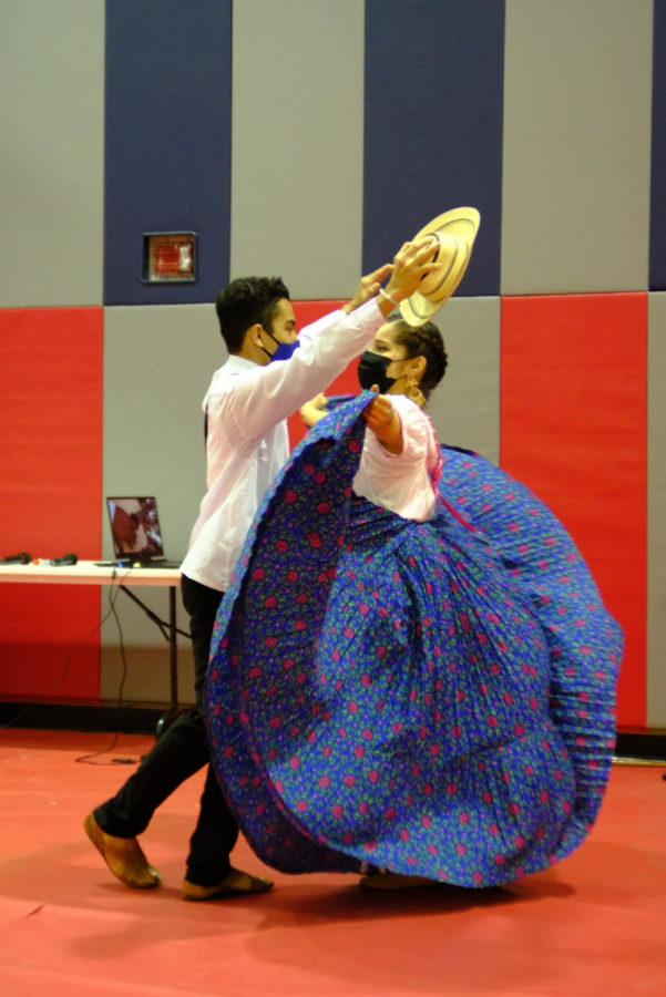 Claberith Delena, English program student, and Eric Espino, freshman civil engineering major, dance the cumbia, a traditional folk dance from Latin America. In Panama, the dance is performed at traditional festivals and celebrations.