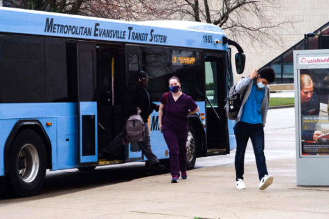 Students exit the Blue Line METS bus outside the Orr Center Thursday after a day off for reflection. There is no plan for any additional days off this semester.