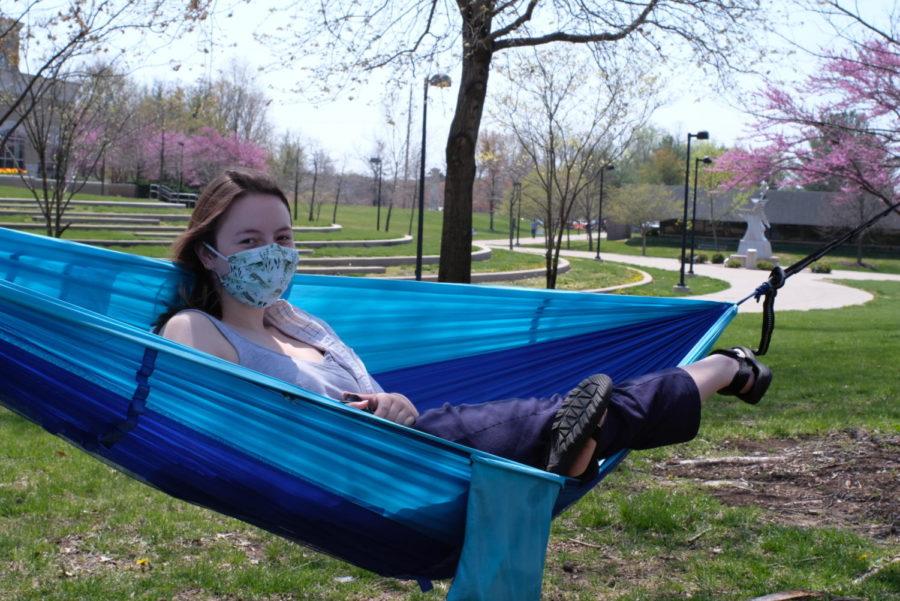 Kasey Hunt-Short relaxes in her hammock in The Quad. She said that hammocking improves her mood especially when the weather is nice.