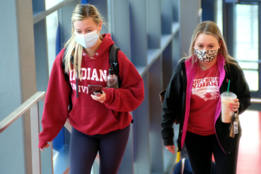 Freshmen radiology majors Olivia Lacer and Heather Conrad arrive at the Screaming Eagles Arena Wednesday morning. Lacer and Conrad served as greeters and helped coordinate traffic in the Arena.