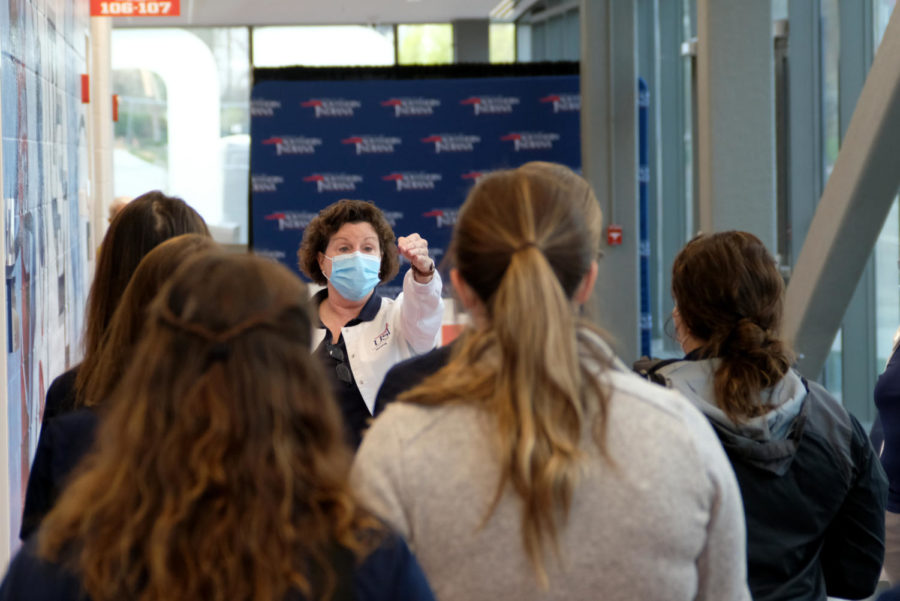St. Claire directs the student nurses to their stations Wednesday. There are 12 vaccination stations in the Screaming Eagles Arena.