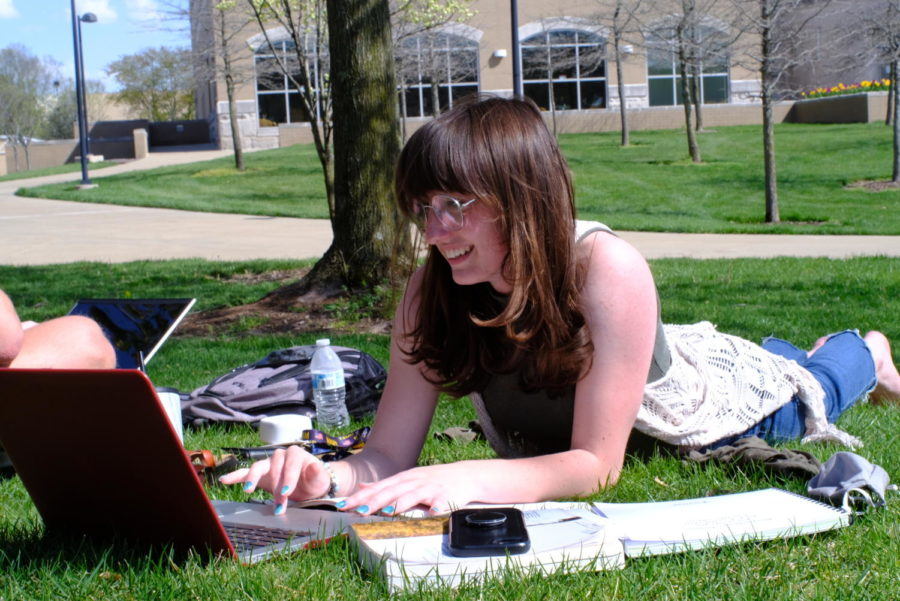 "Makayla Schirmer, senior health services major, finishes up a paper for her class. ""The funny thing is, even though it"