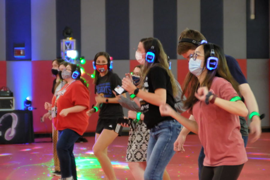 Students dance the Cupid Shuffle in the Recreational Fitness and Wellness Center as part of the silent disco event Friday. A silent disco is where people dance with a wireless headset rather than with a speaker system.