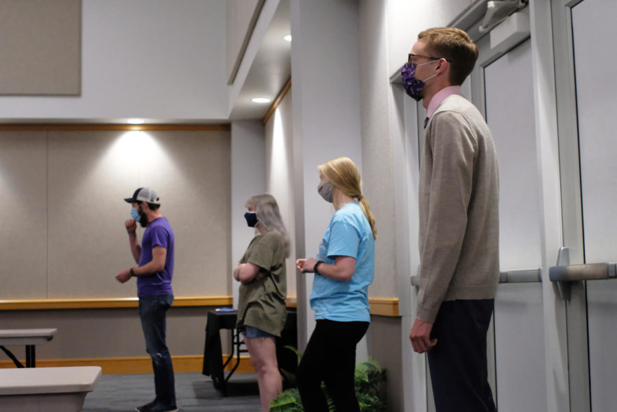Students line up for questions in Carter Hall as the discussion opens up to attendees.