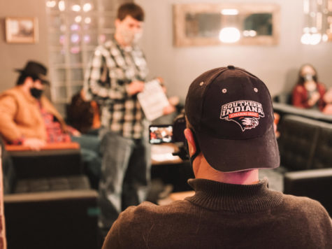 """Students film """"The Laramie Project"""" at The Rooftop Food and Drinks on Martin Luther King Jr. Boulevard. The theater department adapted the play to film because it required multiple set changes."""