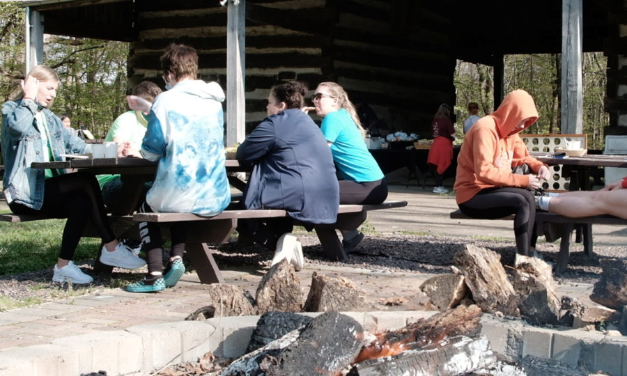 Students socialize outside the Eicher Barn as part of the campfire event Thursday. Outdoor games like hillbilly golf and Frisby were included in the event.