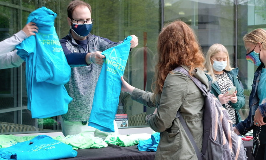 Program Coordinator Nathan Payne hands out T-shirts to students on April 14. Payne said that the shirts say