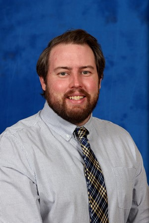 """Cameron Kainer, swimming and diving head coach, is the first head coach of the new univeristy swimming and diving program. Kainer said """"Seeing the success that USI has had athletically and academically drew me here."""""""