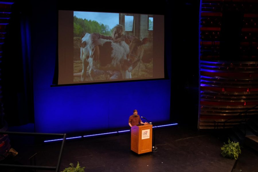 Rob Southard presents his piece titled Ila & Claf in The Performance Center. The photograph is part of a series called Why Buy the Cow which documents the lives of a family that lives and works on a dairy farm.