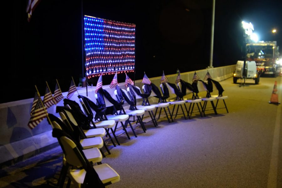 Chairs remain empty in full view of the flag honoring 13 local firefighters who lost their lives serving in Afganistan.