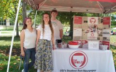 Business Manager, Cobi Schieferstein, Editor-in-Cheif, Shelby Clark and Sports Editor, Pat Baker, stand at The Shield's booth during the Fall Student Involvement Fair September 1, 2021.