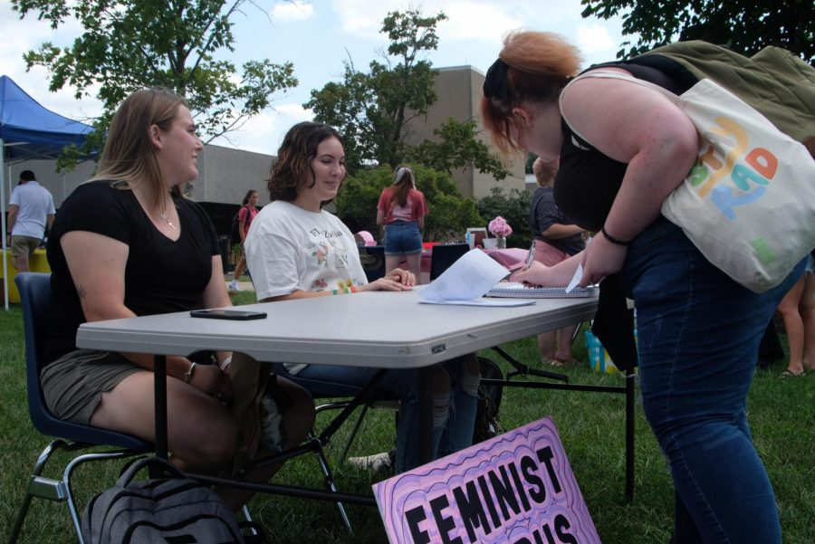 Abby Sink writes her contact information for Feminist Campus USI at the Student Involvement Fair Wednesday. Feminist Campus was founded in 1997 to create a growing feminist presence on campuses nationwide. USIs chapter was founded a year ago.