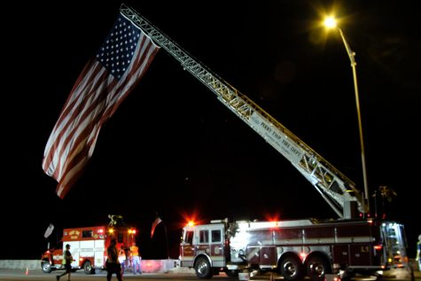 The American Flag is fully raised over the Lloyd Expressway. Over five fire departments took part in the raising of the flag early Saturday morning. This is the first year firefighters plan to have the flag raised for a 24-hour period.