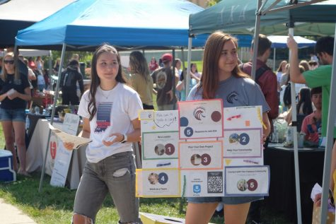 """Elissa Tam, president of Eagles in Action stands with senior Biology major Kendall Baldwin, outside of their booth Wednesday. """"The good thing about our group is that you can participate in any way,"""" Baldwin said. """"You don"""