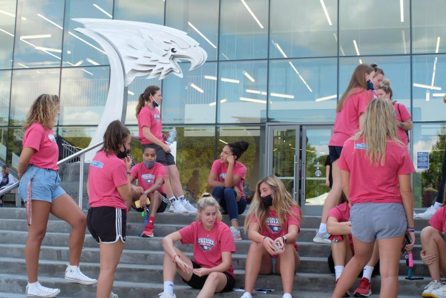 Members of the womens basketball team wait outside before leading tours. The men and womens basketball teams and exercise science club led tour groups around the new athletic facilities.