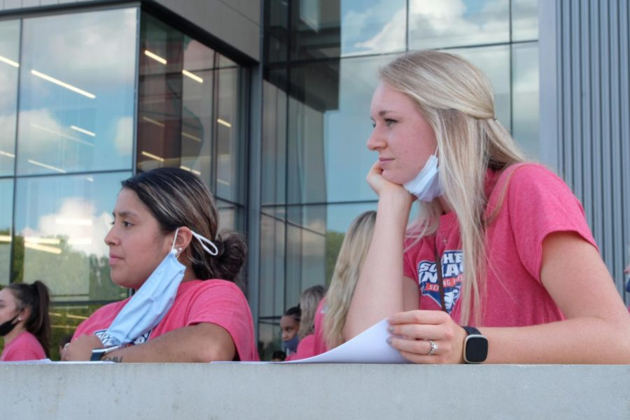Gina Flores, junior exercise science major, and Elizabeth Dauby, senior exercise science major, wait for the celebration event to begin Thursday evening. Flores and Dauby helped lead tours through the Screaming Eagle Arena, Screaming Eagle Complex and Aquatic Center.