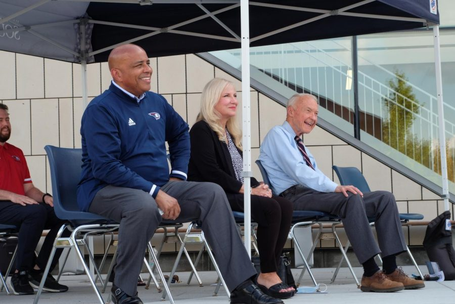President Ronald Rochon, Joan Kempf deLong and Tim Mahoney smile as Khalilah Doss, vice president of student affairs, speaks Thursday evening. Doss said, It is evident that we are excited as a college community for the opening of our Screaming Eagles Arena and Aquatic Center.