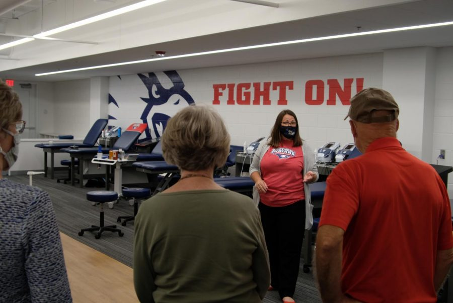 Holly Delph, administration associate, gives a tour of the rehabilitation room in the Screaming Eagles Complex. In addition to the rehabilitation room, the SEC houses the student-athlete weight room, locker rooms and athletic department offices.