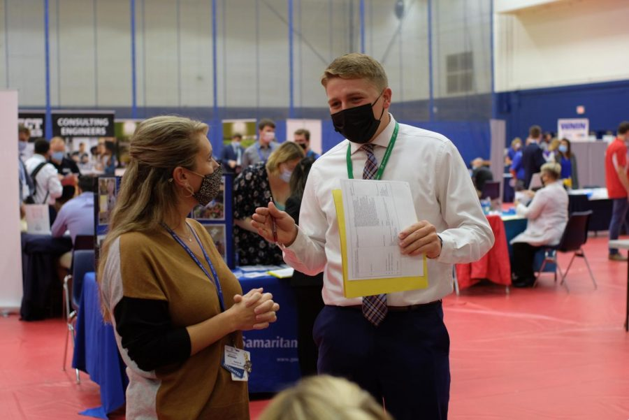 Max Stoll, freshman biology major, chats with Natalie Will, a recruiter for Deaconess Hostpital,  Wednesday