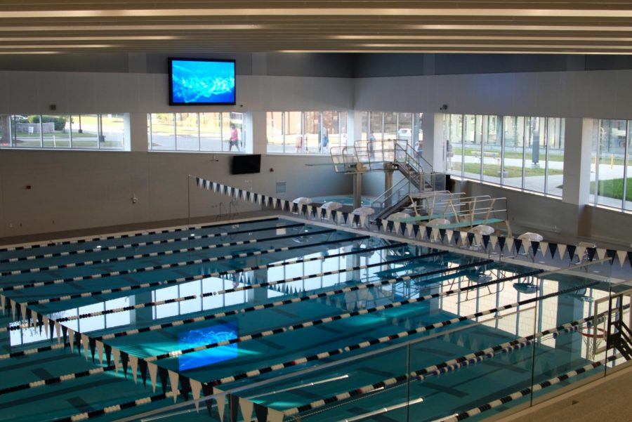 The Aquatic Center will open in Fall 2021. The left lanes of the 25 by 23 meter pool are the diving lanes and are 13 feet deep. The lanes on the far right of the pool are warm-up lanes that are four feet deep.