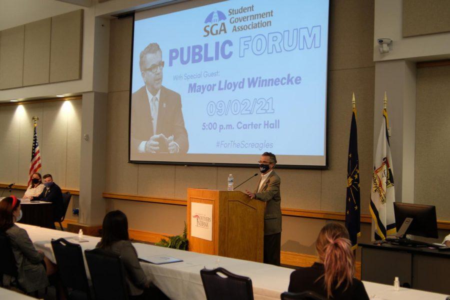 Evansvile mayor Lloyd Winnecke speaks at SGA's first publc forum in Carter Hall Thursday. Winnecke spoke on multiple topics relating to the Evansville community.