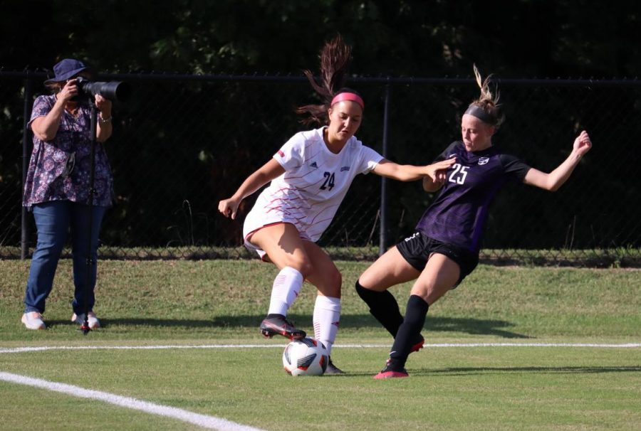 Midfielder Peyton Wilkinson defends against Trevecca Nazarene in Thursday's game. It was 82 degrees as the women's soccer team kicked off the season.