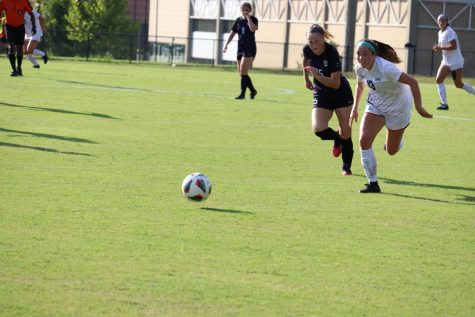 Forward Katlyn Andors chases after the ball against Trevecca Nazarene. The womens soccer team won opening game 2-0.