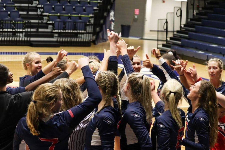 The women's volleyball team gathers after winning the first game of the invitational Thursday. The team won all four of their games in the invitational.