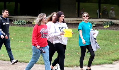Students walk in Suicide Awareness Memory Walk Saturday. The walk was hosted by Active Minds, a mental health and suicide prevention organization.