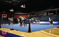 The USI Cheer team kicks off the Midnight Madness festivities by performing cheers and stunts for fans Thursday night at the Screaming Eagles Arena.