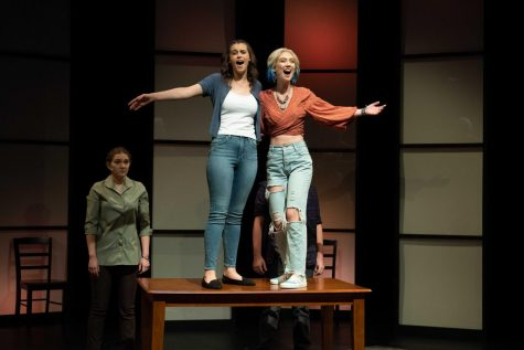 Students perform The Mad Ones as part of USI Theatres Fall 2021 productions.  Samantha Brown (Evelyn Pigman) and Kelly (Clare McGregor) sing about their future in front of Sams mom Beverley (Grace Koltz) and Sams Boyfriend Adam (Nate Jenkins).
