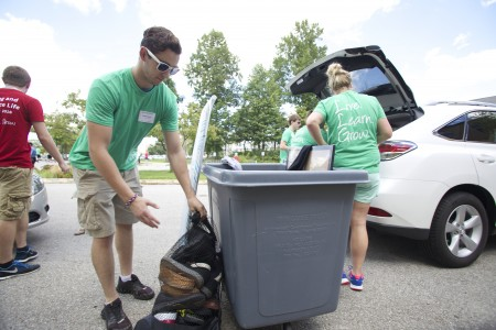 Move in crew welcomes new students by doing their heavy lifting