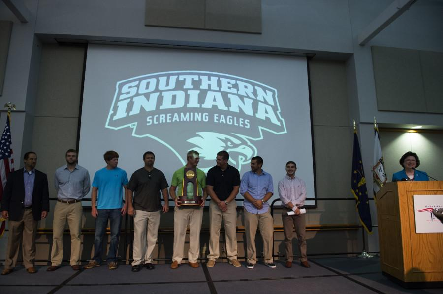 Division II national baseball champions surprised faculty during their annual fall meeting Tuesday in Carter Hall.