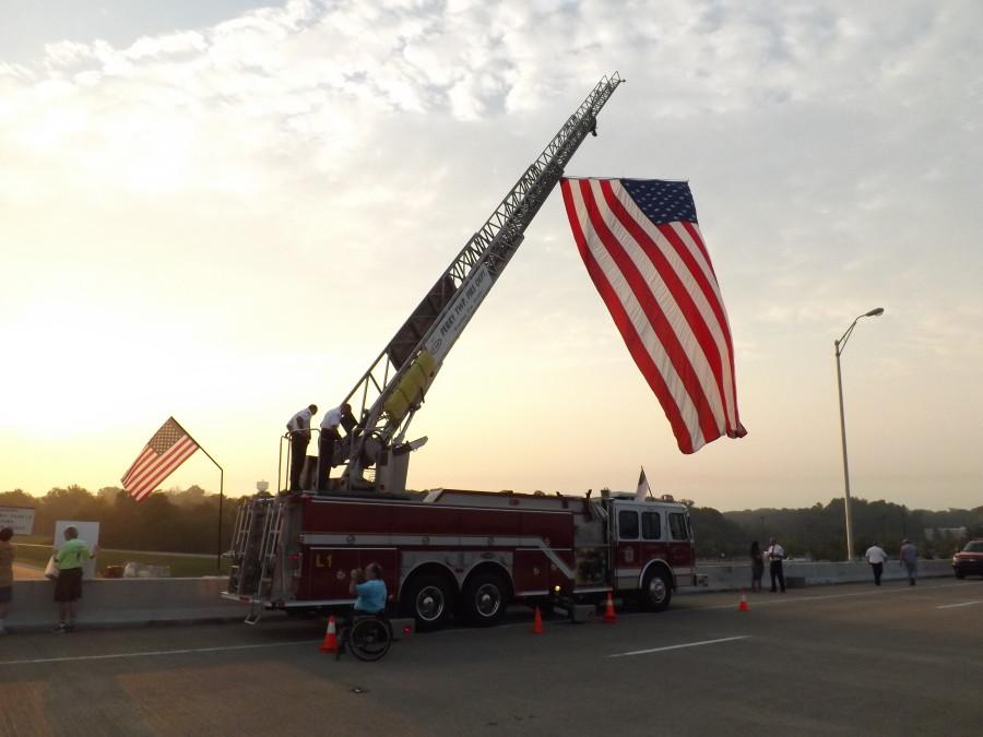 An American flag hangs over the Lloyd Expressway by way of the Perry Township Fire Department Wednesday morning to commemorate Sept. 11, 2001.   By Caleb Riley/The Shield