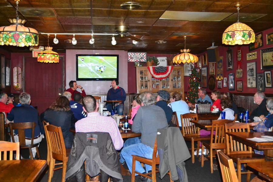 Photo by Sarah Loesch/The Shield Radio sportscaster Dan Egierski and assistant men's basketball coach Brent Owen talk about future games in front of a crowded audience Monday night at Turoni's Pizzery & Brewery on Main Street.