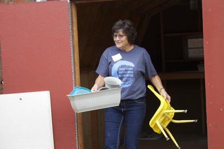 USI volunteer, Jennifer Egli, helps clean out a toy shed at the Arc of Evansville.  The United Way Day of Caring Campaign will last from Sept. 11, 2015 to Dec. 11,2015.
