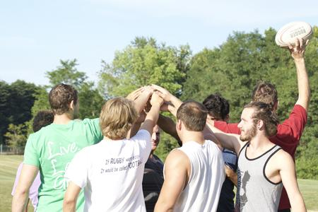 Members of the rugby team huddle before a practice in September. The team won a state title Saturday at the Indiana Rugby Football Union tournament in Indianapolis.