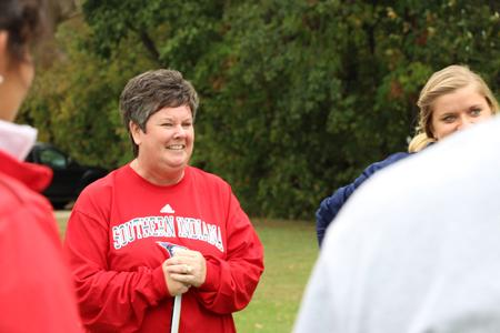 Head coach Lu Anne Howerton gives an itinerary for the girl's golf team practice on Thursday.