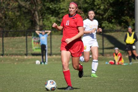 Senior forward Madi Vellky dribbles down the field during a game against Quincy University Oct. 18. Vellky recently was named Division II Women's Soccer Academic All-District IV by the College sports Information Directors of America for the second time in her USI career.