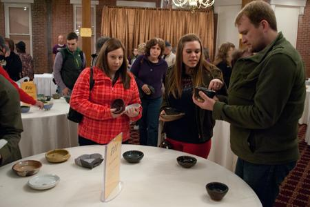 A large crowd of people bumped shoulders and clinked bowls as they made their way through Kirby's Fine dining Saturday during the 2014 Empty Bowls event, which sold out in just two hours.