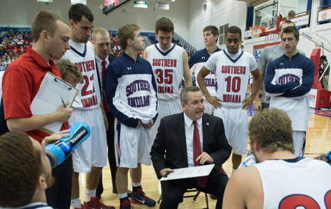 Head coach Rodney Watson lays out the game plan to members of the 2014-15 men's basketball team during a game agaisnt Davis Elkins College. Watson is the ninth head coach for the men's team and 2015-16 will be his seventh coaching season.