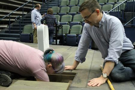 """Senior theatre arts major Christy Thompson sets up a """"trap"""" for a pretend fire with Paul Weimer on the set of """"The Grapes of Wrath"""" at the Performance Center."""