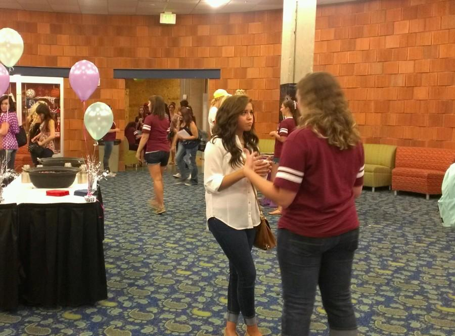 Several women gather at the Sorority Meet-N-Greet Thursday night to learn about the different sororities on campus.  Photo by SHANNON HALL/ The Shield