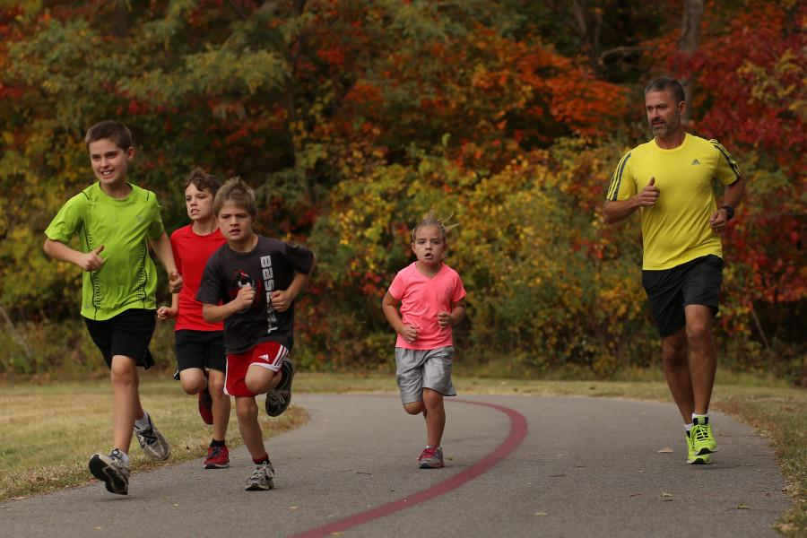 The Centifanto family, (from left to right) Andrew, 12, Jonathan, 10, Luke, 7, Sarah, 6, and the father Bill, take a run on the USI Burdette trail Saturday during Celebrate the Trail.