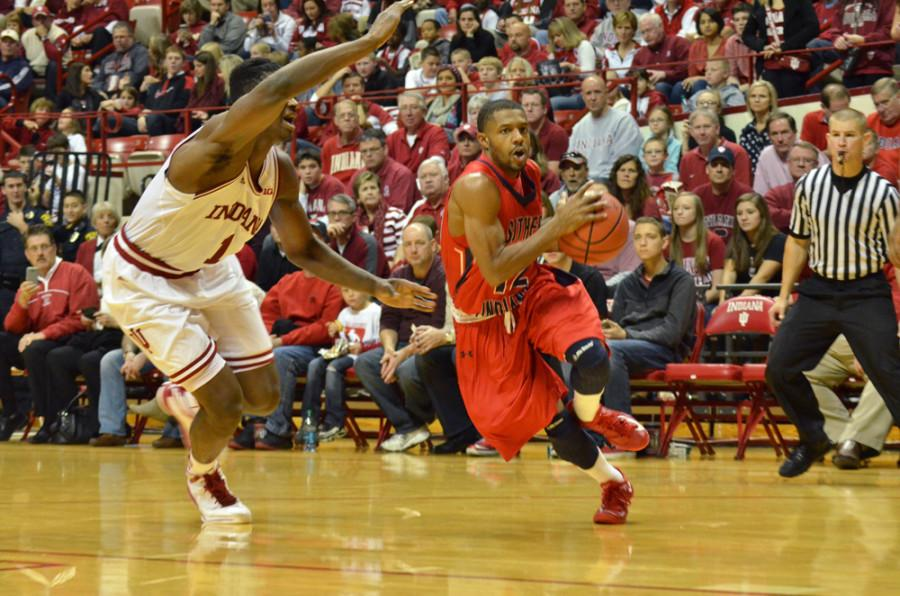 Southern Indiana senior guard Lawrence Thomas drives to the basket in last month's exhibition game at Indiana University in Bloomington. PHOTO by JIMMY PYLES