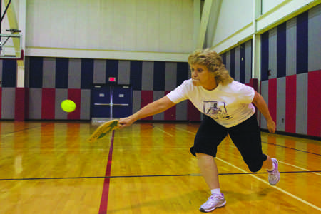 Sherry Tynes, the Information Systems Associate in the USI Foundation office, returns a serve during a game of Pickle Ball during their weekly faculty game.